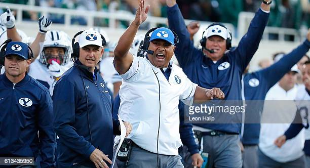 Brigham Young Cougars head football coach Kalani Sitake reacts to a first down during the fourth quarter of the game against the Michigan State...
