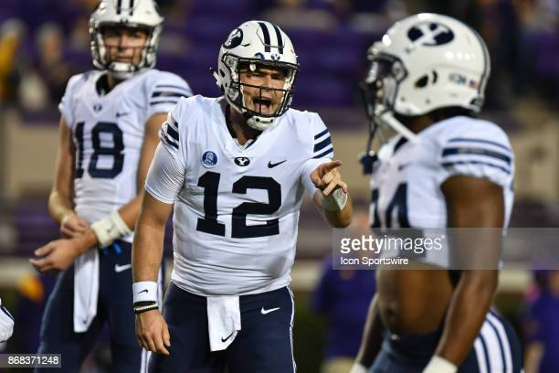 Brigham Young Cougars quarterback Tanner Mangum calls a play during a game between the BYU Cougars and the East Carolina Pirates at DowdyFicklen...