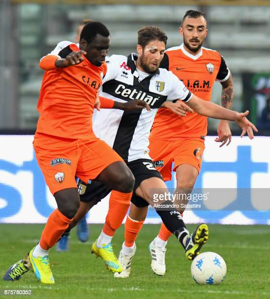Bright Addae of Ascoli Picchio competes for the ball with Manuel Scavone of Parma Calcio during the Serie B match between Parma Calcio and Ascoli...