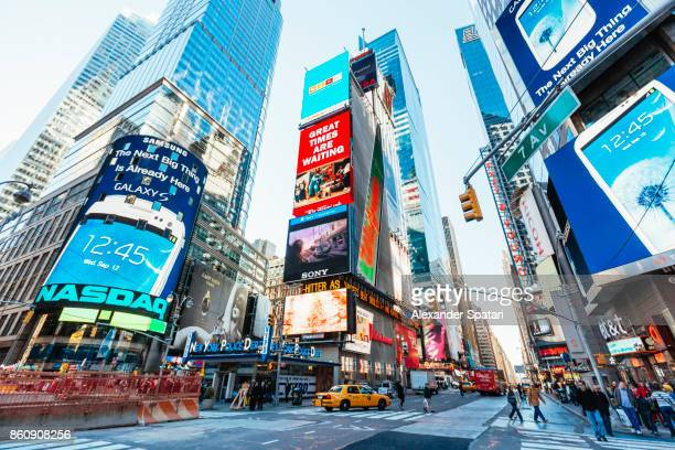 bright advertising screens on times square, manhattan, new york city, usa - broadway manhattan stock photos and pictures