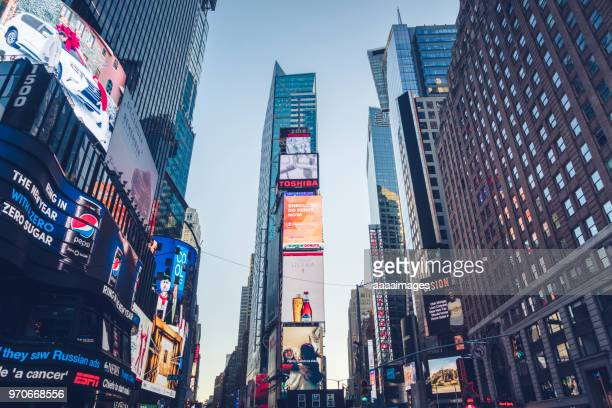 bright advertising screens on times square,new york - times square manhattan stock pictures, royalty-free photos & images