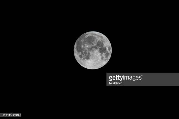 Bright and beautiful full moon illumination in the dark night sky the traditionally known Beaver Moon, as seen from Eindhoven, a city in mainland...