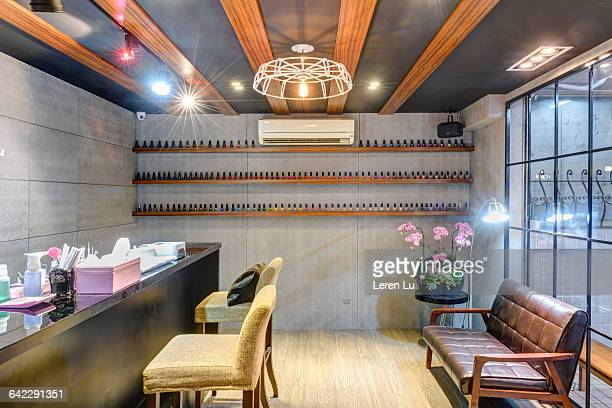 bright and comfortable manicure shop - nail salon stock pictures, royalty-free photos & images