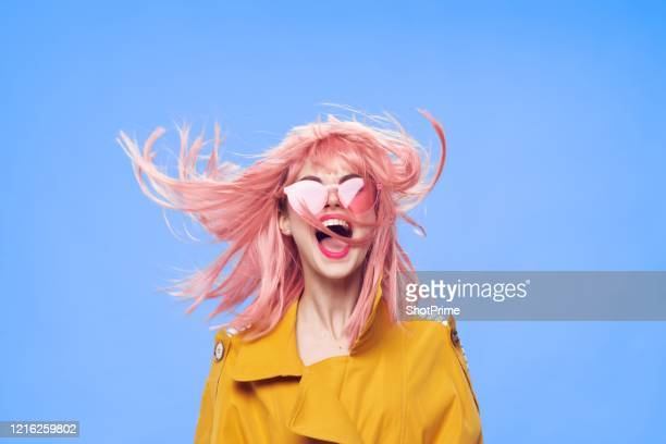 bright and fashionable teenager girl hipster with pink dyed hair with bright accessories and bright makeup screams in delight. - purple dress stock pictures, royalty-free photos & images