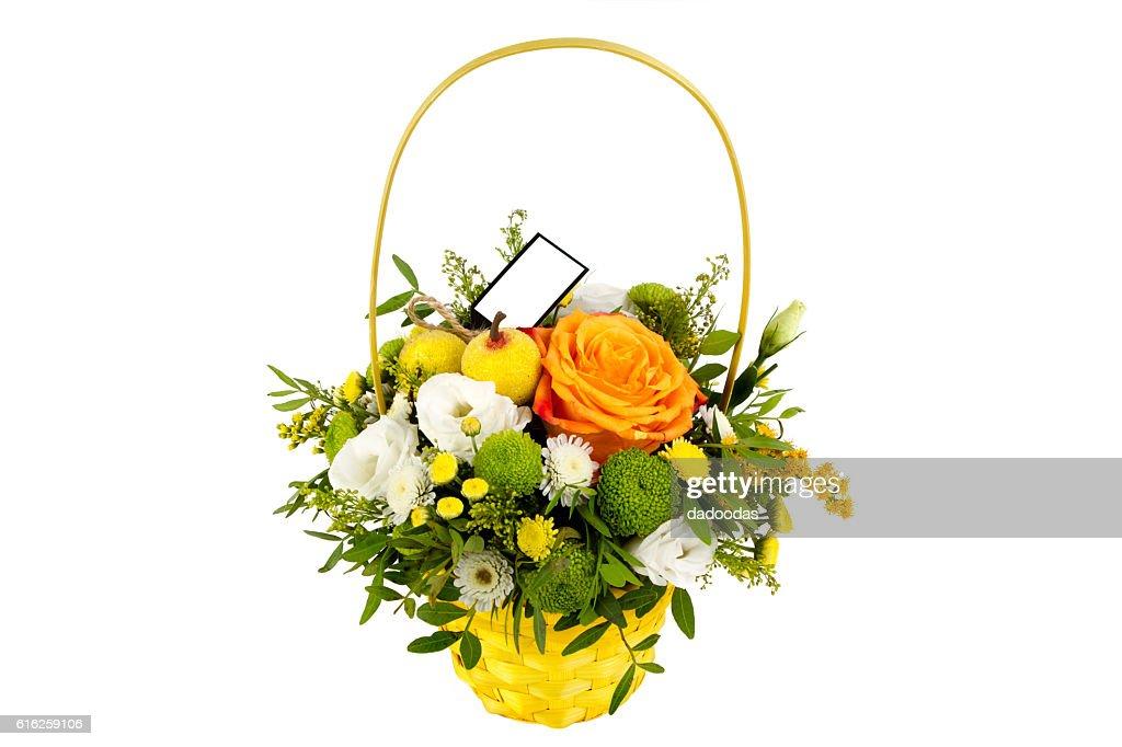 bright arrangement of flowers in basket, isolated background : Foto de stock