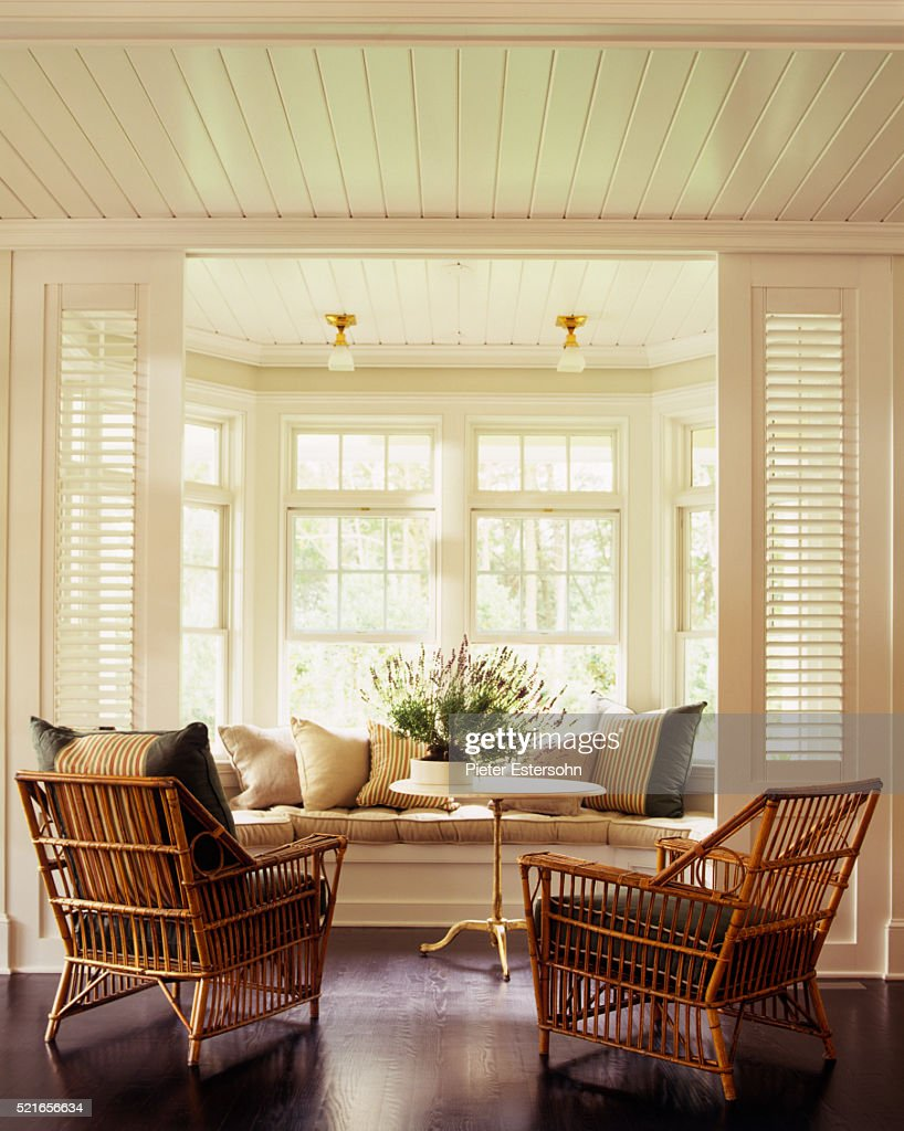 Bright bay window and two rattan armchairs