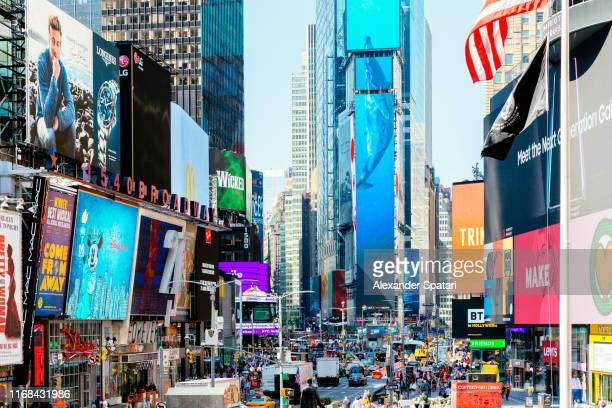 bright billboards at times square, new york city, usa - times square manhattan stock pictures, royalty-free photos & images