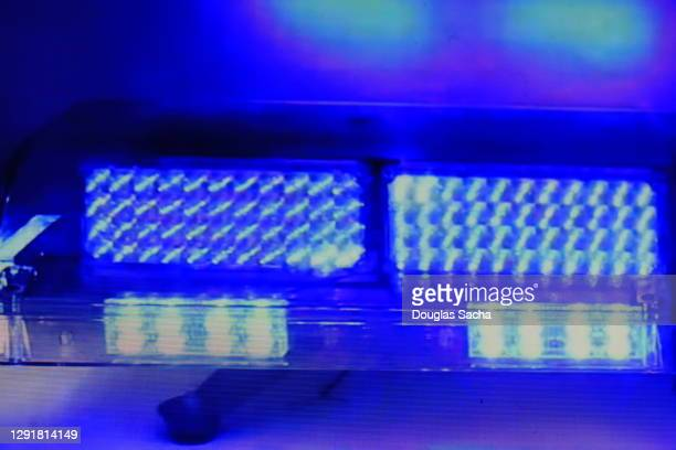 bright blue colored police car lights flashing - streaker stock pictures, royalty-free photos & images