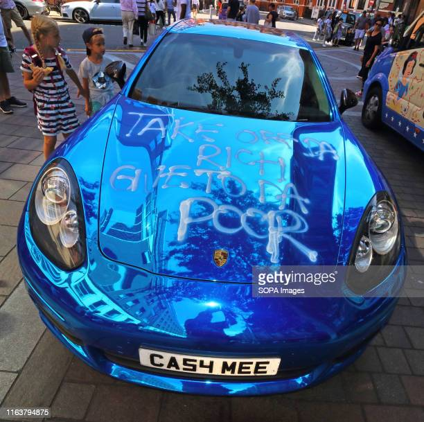 Bright blue Porsche Supercar parked outside London's famous Harrods store in Knightsbridge vandalised. It is unknown whether it was part of some kind...