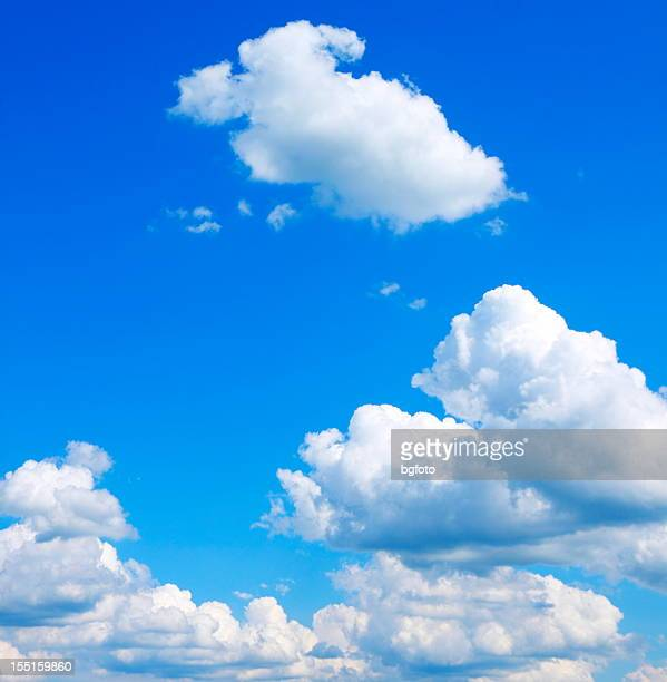 bright blue sky with puffy clouds - cumulus stock pictures, royalty-free photos & images