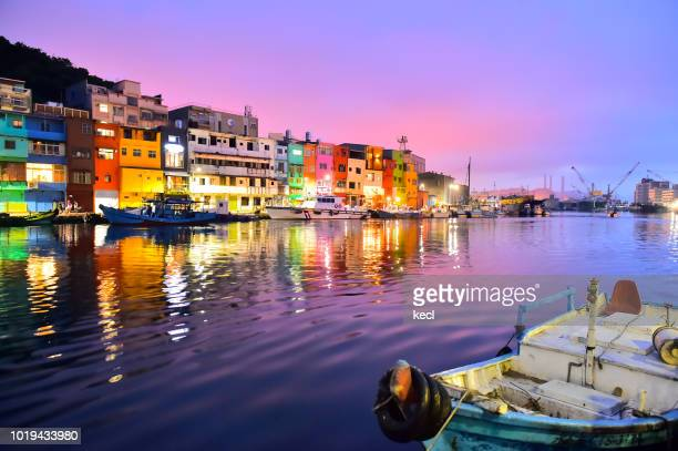 bright colored buildings in zhengbin fishing port, keelung , taiwan - hollywood california stock pictures, royalty-free photos & images