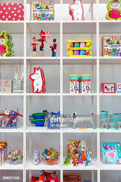 Bright colored children's toys souvenirs and Moomin by Tove Jansson characters in shop Arken Museum of Modern Art on June 24 2015 near Copenhagen...