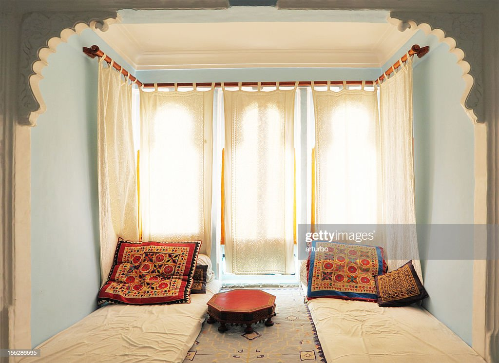 bright colorful relax room with white curtains and  mattress India : Stock Photo