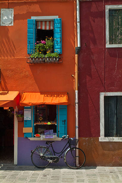 Bright colors and lone bicycle  in Burano, Italy