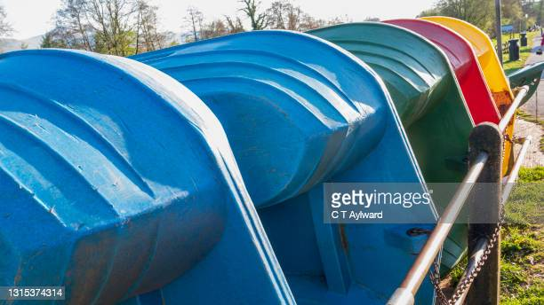 bright coloured paddle boats - passenger craft stock pictures, royalty-free photos & images