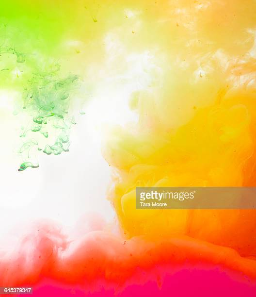 bright coloured paint in water