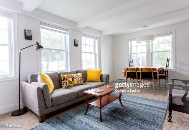bright, eclectic  living room, clean and ready - catherine ledner stock pictures, royalty-free photos & images