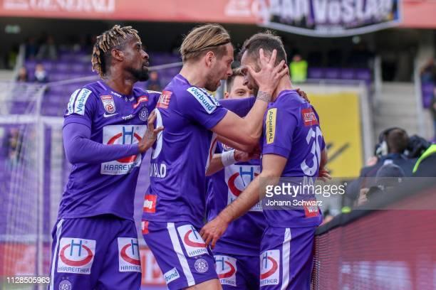 Bright Edomwonyi, Alexander Gruenwald, Dominik Prokop and scorer Michael Madl of Austria Wien celebrate after scoring a goal during tipico Bundesliga...