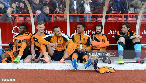 Bright Enobakhare Bradley Reid Connor Hunte Nathan Byrne Jack Price and Damian Martinez of Wolverhampton Wanderers sit on the substitutes bench...