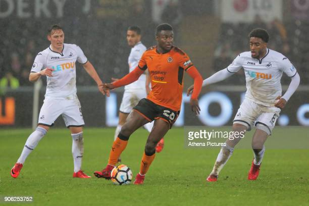 Bright Enobakhare of Wolverhampton Wanderers against Connor Roberts of and Leroy Fer during the Emirates FA Cup match between Swansea and...