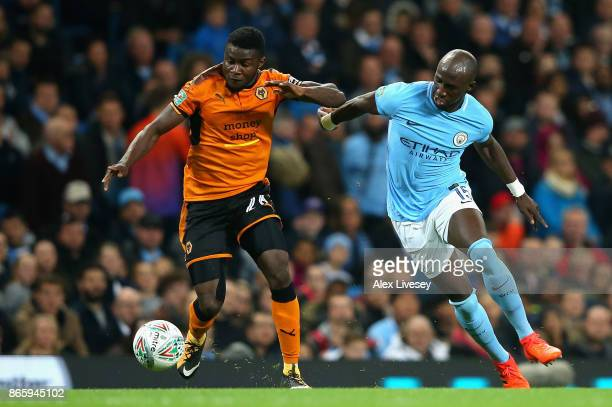 Bright Enobakhare of Wolverhampton Wanderers and Eliaquim Mangala of Manchester City battle for the ball during the Carabao Cup Fourth Round match...