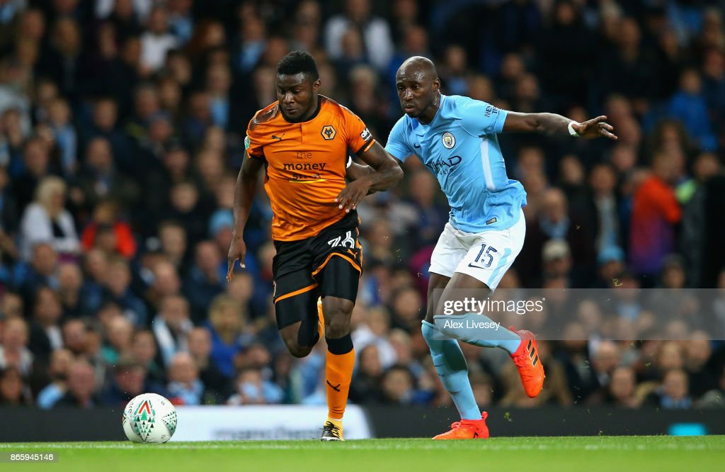 Bright Enobakhare of Wolverhampton Wanderers and Eliaquim Mangala of Manchester City battle for the ball during the Carabao Cup Fourth Round match between Manchester City and Wolverhampton Wanderers at Etihad Stadium on October 24, 2017 in Manchester, England.