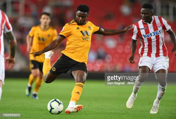 Bright Enobakhare of Wolverhampton Wanderers and Peter Etebo of Stoke City during the PreSeason Friendly match between Stoke City v Wolverhampton...