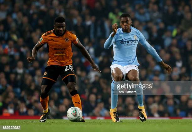 Bright Enobakhare of Wolverhampton Wanderers and Tosin Adarabioyo of Manchester City battle for possession during the Carabao Cup Fourth Round match...