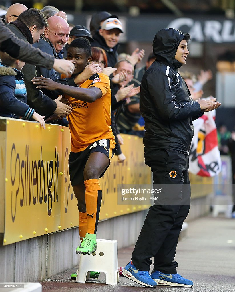 Bright Enobakhare of Wolverhampton Wanderers celebrates with the fans after scoring a goal to make it 1-0 during the Capital One Cup match between Wolverhampton Wanderers and Barnet at Molineux on August 25, 2015 in Wolverhampton, England.
