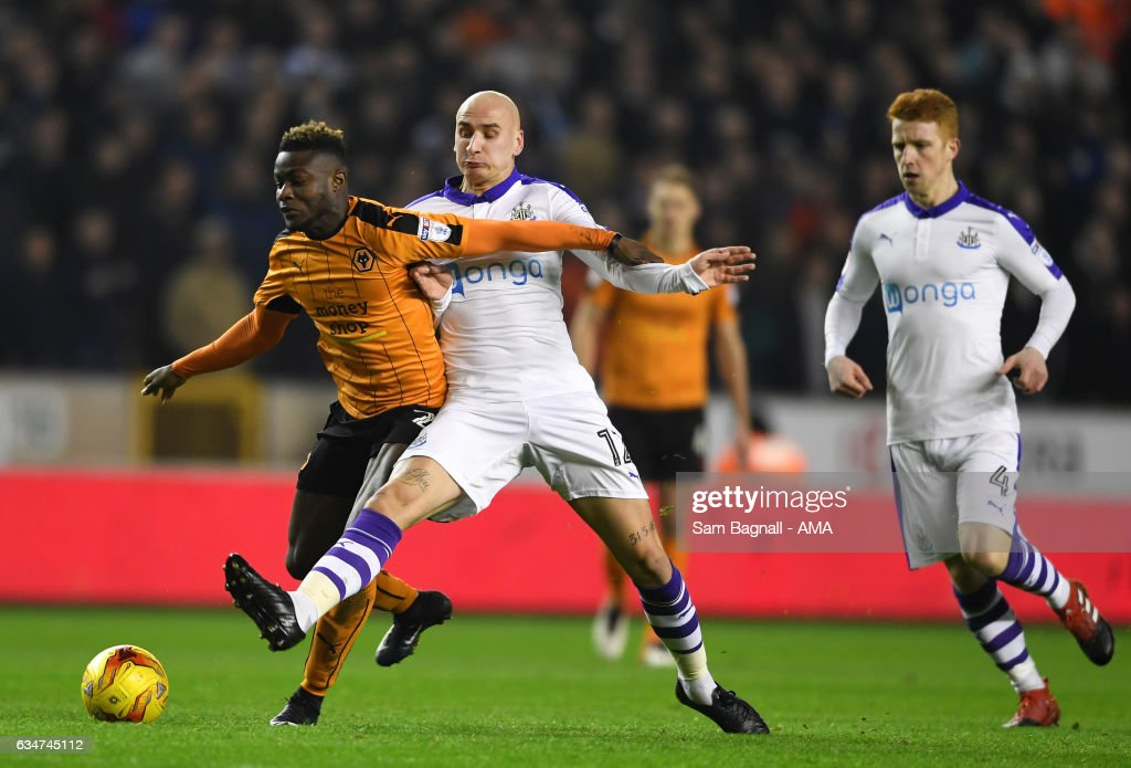 Bright Enobakhare of Wolverhampton Wanderers is fouled by Jonjo Shelvey of Newcastle United during the Sky Bet Championship match between Wolverhampton Wanderers and Newcastle United at Molineux on February 11, 2017 in Wolverhampton, England.