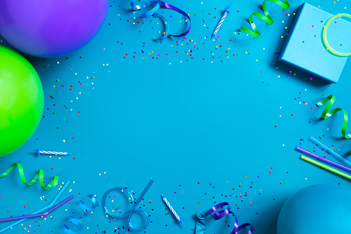 Bright festive blue background with birthday party accessories 1093222958