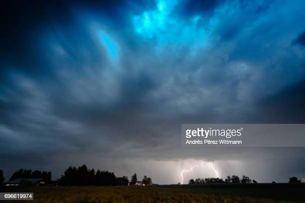 Bright flashes and lightning in the evening with dark thunderclouds
