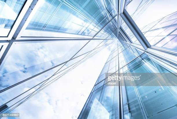 bright future, finance buildings seen from below - arquitetura imagens e fotografias de stock
