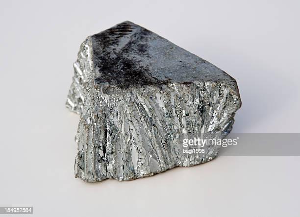 Bright gray zinc mine nugget on white background