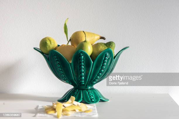 bright green bowl with pears and lemons - dorte fjalland stock pictures, royalty-free photos & images