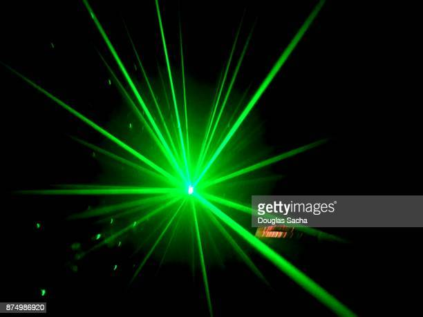 Bright green colored laser light beam