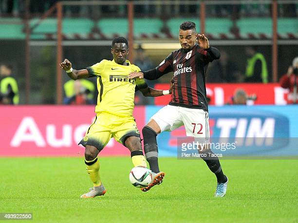 Bright Gyamfi of FC Internazionale competes for the ball with Kevin Prince Boateng of AC Milan during the Berlusconi Trophy match between AC Milan...