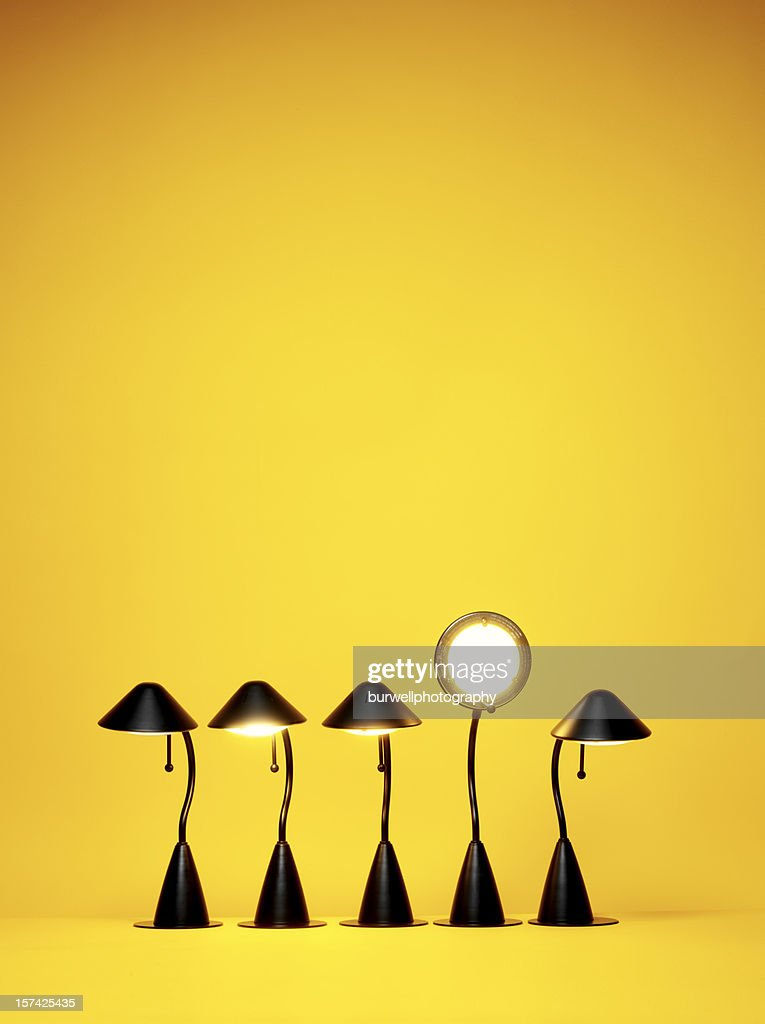 Bright Idea, Five desk lamps against yellow : Stock Photo