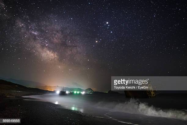 Bright Illuminated Milky Way And Constellations At Night