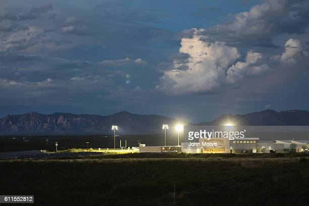 Bright lights glow at dusk over the football field of Tombstone High School on September 29 2016 in Benson Arizona Tombstone once the last wideopen...