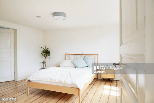 bright modern bedroom in an old country house - camera da letto foto e immagini stock