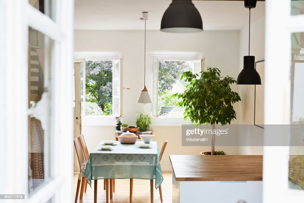 Bright modern kitchen and dining room in an old country house : Stock Photo