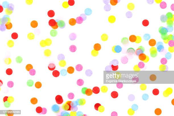 bright multicolored confetti isolated on white background. - confetti stock pictures, royalty-free photos & images