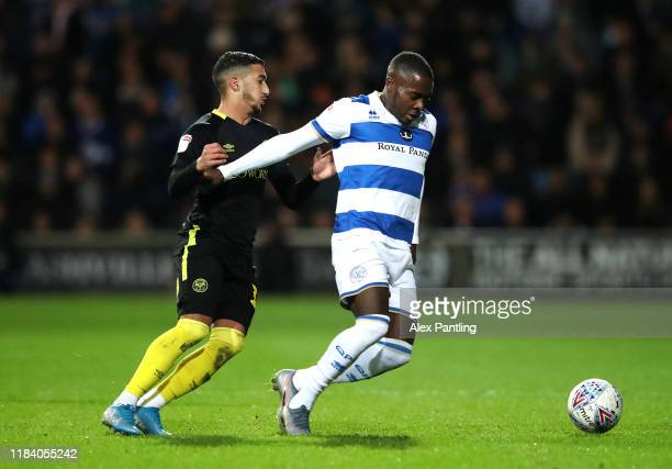 Bright OsayiSamuel of QPR is tackled by Said Benrahma of Brentford during the Sky Bet Championship match between Queens Park Rangers and Brentford at...