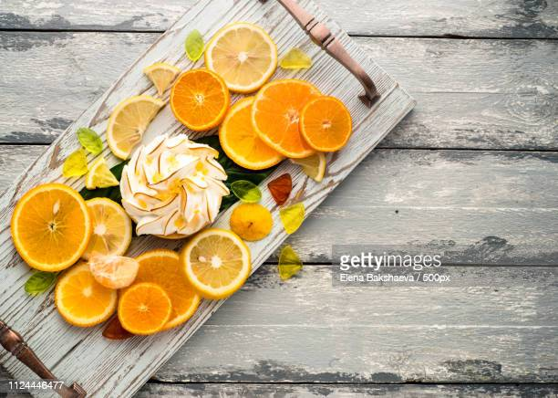 Bright Photo Of Lemon Tart And Different Citrus Fruits