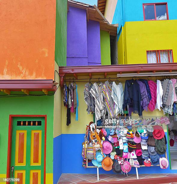 Bright primary colors in a street with painted houses and market stall, Guatape, Colombia