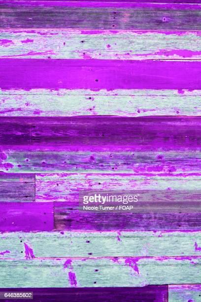 Bright purple on wood panel