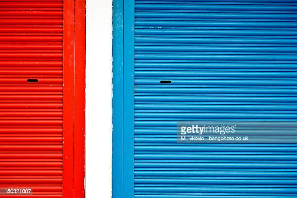 Bright red and blue roller shutters divided