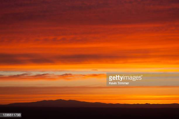 bright red and orange sunset over mountain - arizona stock pictures, royalty-free photos & images