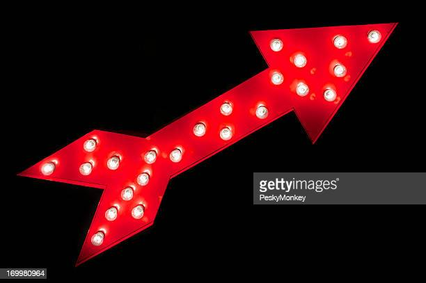 Bright Red Arrow with Lights on Black Background